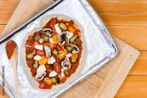 Fotografie, Obraz  Hand tossed homemade vegetarian pizza