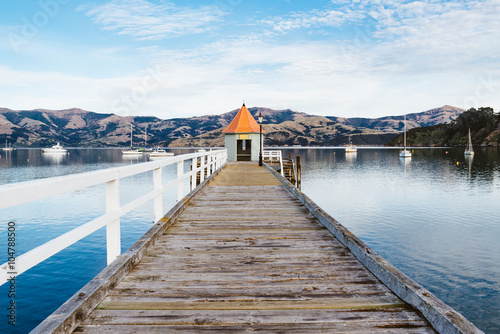 Poster Nieuw Zeeland Jetty pier building on lake at Akaroa ,South Island New Zealand, Toned Image