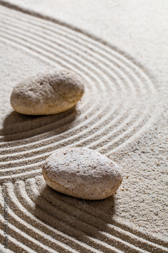 Acrylic Prints Stones in Sand zen sand still-life - stones set on sinuous lines for concept of change or separation with inner peace