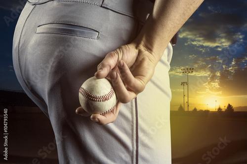 Fototapeta Baseball pitcher ready to pitch in an evening baseball game obraz