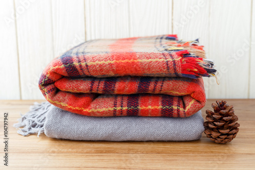 Winter fashion clothing and blanket with wood background Poster