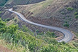Downhill Curves on a Mountain Road