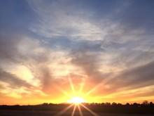 Bright Orange Sunrise On The Horizon