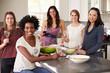 Portrait Of Female Friends Enjoying Pre Dinner Drinks