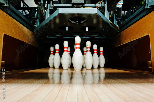 Ten white pins in a bowling alley lane Wallpaper Mural