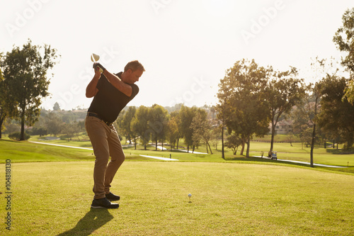 Deurstickers Golf Male Golfer Lining Up Tee Shot On Golf Course