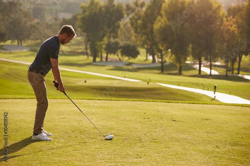 Deurstickers Golf Male Golfer Lining Up Tee Shot On Golf Course