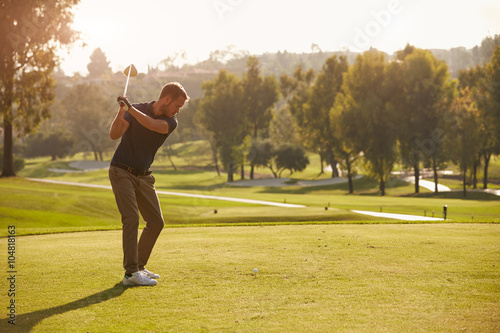 Spoed Foto op Canvas Golf Male Golfer Lining Up Tee Shot On Golf Course