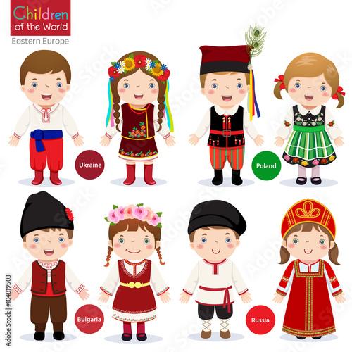 Fotografia Kids in different traditional costumes (Ukraine, Poland, Bulgari