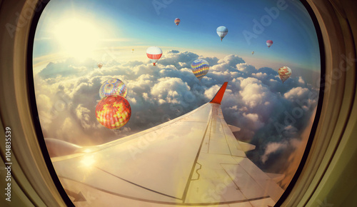 Clouds ,sky and Balloons as seen through window of an aircraft - 104835539