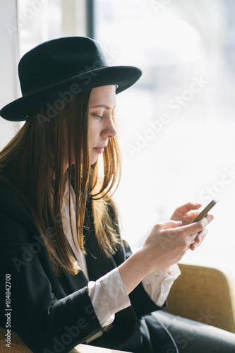 Stampe  Beautiful woman using her mobile
