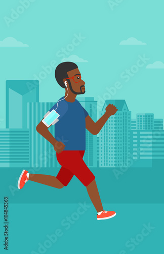 Fototapety, obrazy: Man jogging with earphones and smartphone.