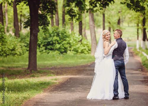 Fotografie, Obraz  Happy bride and groom on their wedding