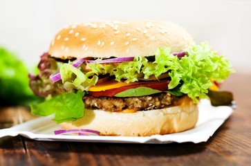 Fototapeta Do steakhouse Fresh Homemade Cheeseburger (vegetarian)