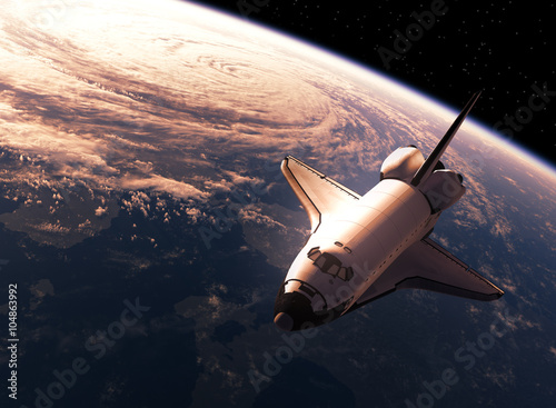 Photo  Space Shuttle Orbiting Eart