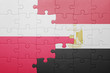 canvas print picture - puzzle with the national flag of poland and egypt
