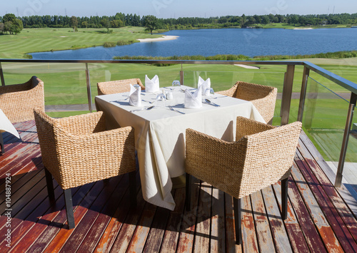 Fotografie, Obraz Table on terrace for eat foods at clubhouse in golf course.