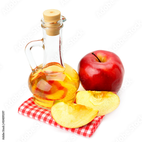 apple cider vinegar and apples isolated on white background