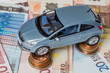 Toy car on money coins