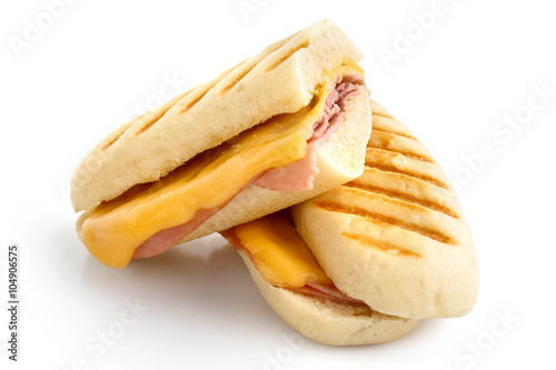 Cadres-photo bureau Snack Cut cheese and ham toasted panini melt. Isolated on white.
