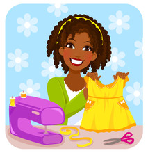 Young Woman Sewing A Dress For...