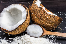 Fresh Coconut And Coconut Oil On Wooden Spoon