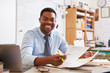 canvas print picture - Portrait of African American male teacher working at desk
