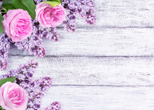 Lilac Flowers With Roses On Ba...