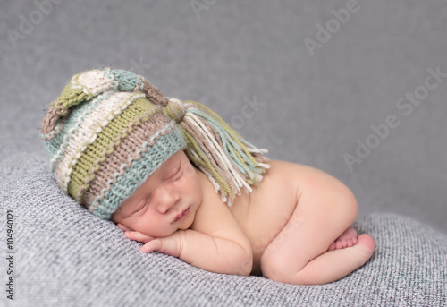 Newborn Baby Sleeping on Blanket