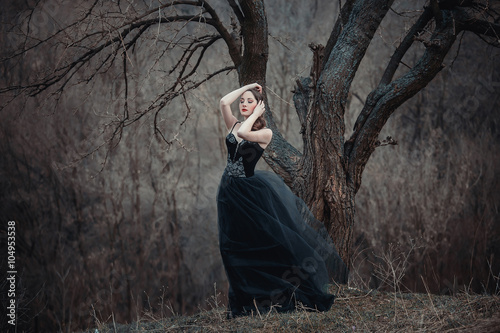 882b4f37439e Beautiful girl with long hair standing in a black dress standing on the  gothic background blowers forests, forest princess, halloween , dark boho  ...