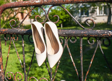 White Wedding Shoes Of Bride In Piano