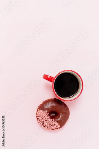 Fototapeta Coffee and donuts on pink background obraz na płótnie