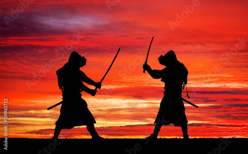 Photo  Silhouette of two samurais in duel. Picture with two samurais
