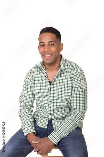 Fotografie, Obraz  Young man sitting on a stool isolated on white