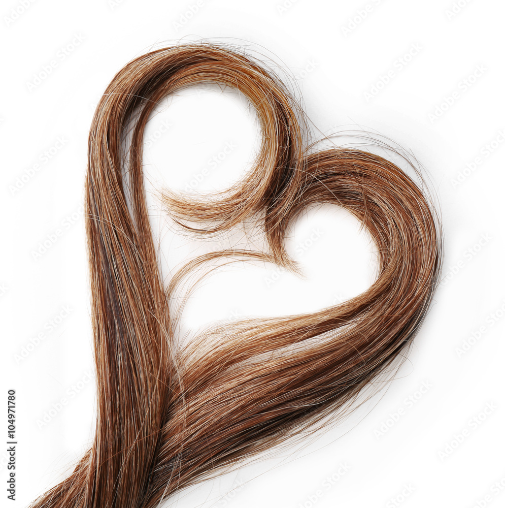 Fototapeta Strands of brown hair in shape of heart, isolated on white