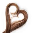 Leinwandbild Motiv Strands of brown hair in shape of heart, isolated on white