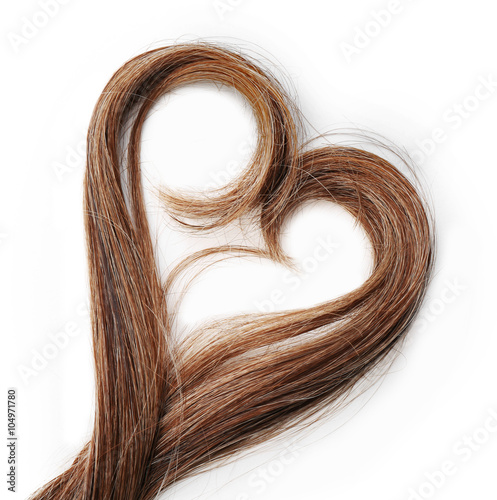 Cuadros en Lienzo Strands of brown hair in shape of heart, isolated on white