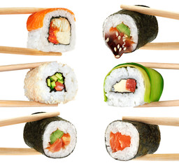 FototapetaSushi rolls isolated on white background. Chopsticks.