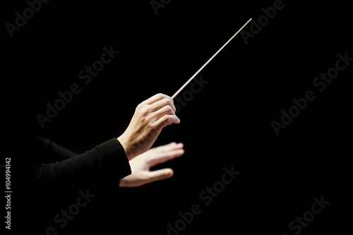 Fotografiet  Hands of conductor on a black background