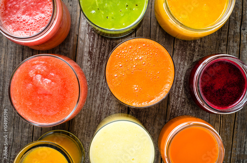 Garden Poster Juice Glasses of fresh juice on an old wooden table