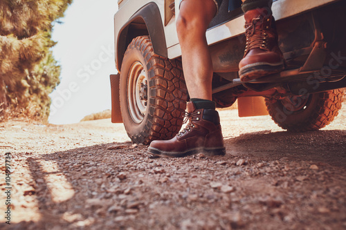 Fotografie, Obraz  Legs of a man sitting on a off road vehicle.