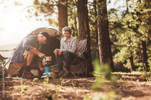 Happy campers making coffee in the wilderness