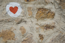 Red Heart On The Stone Wall