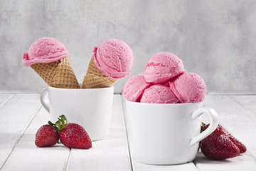 Strawberry ice cream cones and cup.