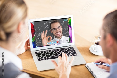 Fototapeta Composite image of happy businessman making okay gesture obraz na płótnie