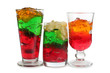 Glass jars with colorful cocktails on a white background