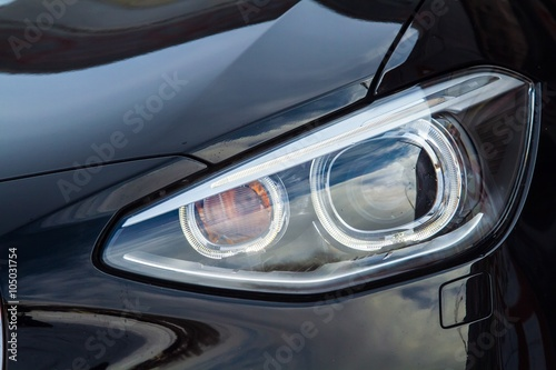 Obraz Closeup of headlights of sport car - fototapety do salonu