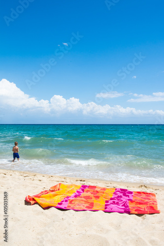 Little child walking on the beach, beach vacation Poster
