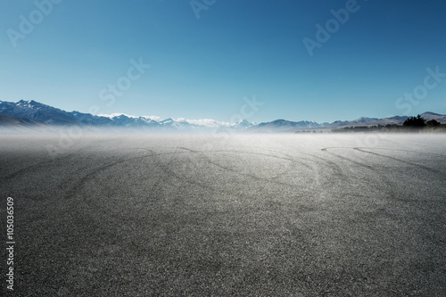 Fotografiet  asphalt road near lake in summer day in New Zealand