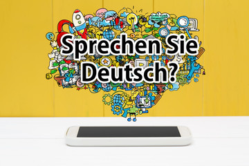 Panel Szklany Podświetlane Berlin Sprechen Sie Deutsch concept with smartphone